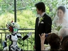 Japanese couple married by robot priest